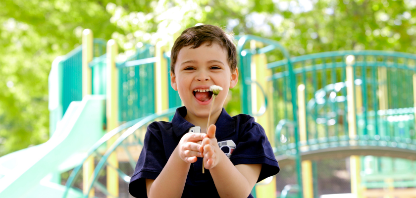 a happy child who applies the new skills he learned from aba therapy