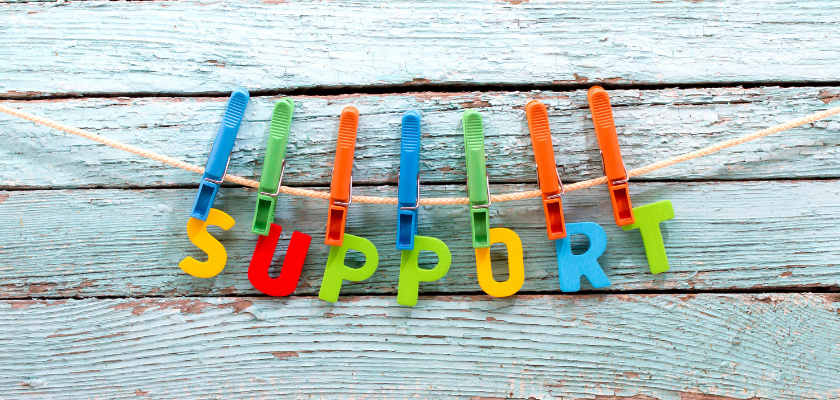 """a beautiful banner that spells out the word """"support"""" all in capital letters."""