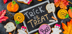 trick or treat sign with halloween decorated cookies